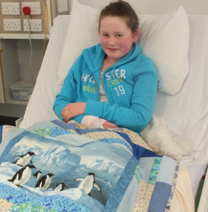 Grace with her penguin quilt