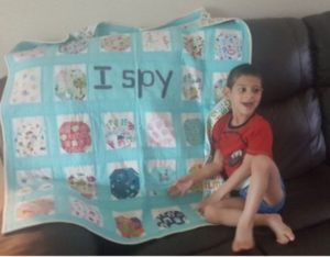Reece with his I-Spy quilt