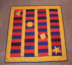 Red, yellow, blue quilt