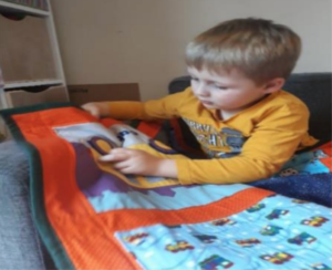 Ruben with his quilt